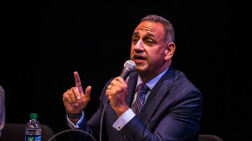 Gil Cisneros, a Democrat running in the 39th Congressional District, speaks at a candidate forum in January.
