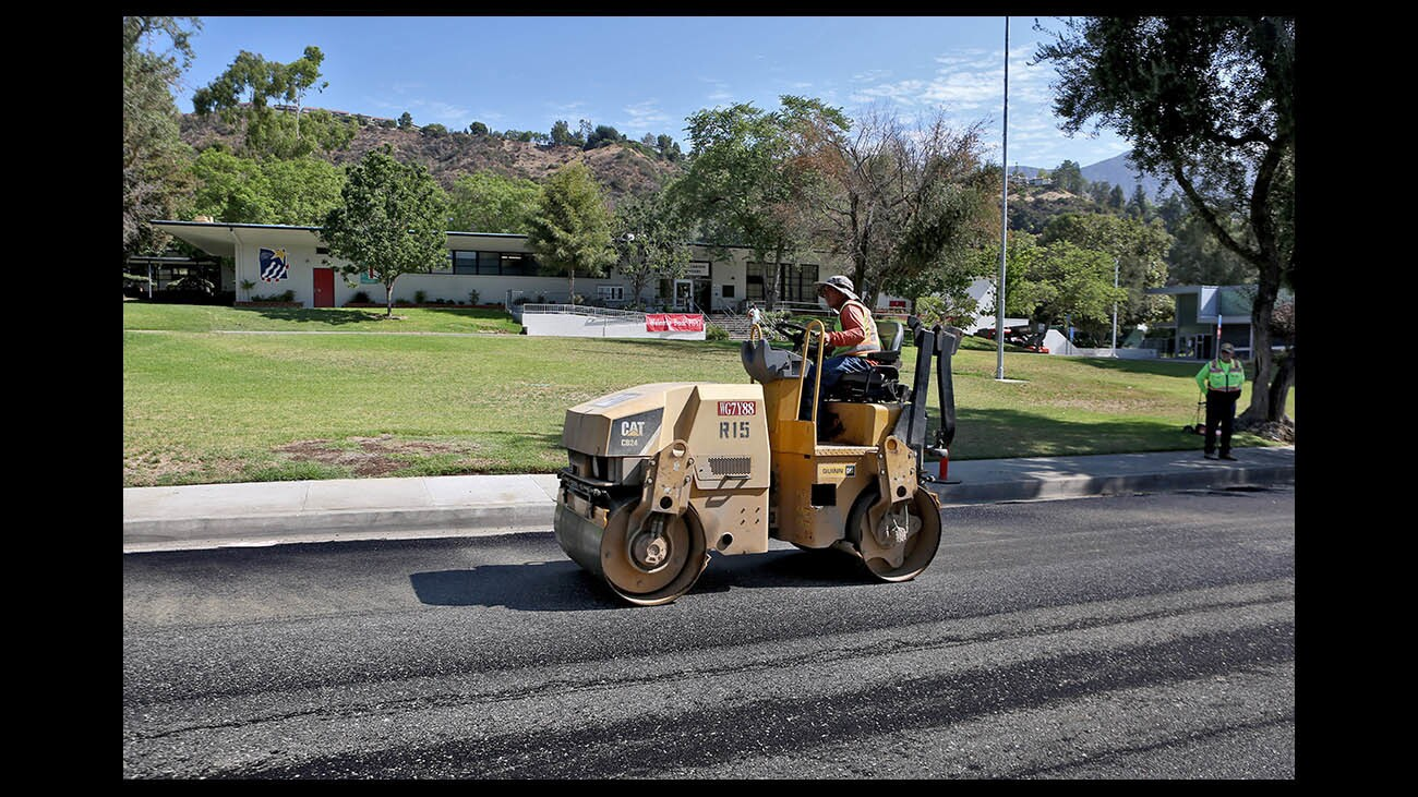 Photo Gallery: Paradise Canyon Elementary streets get new asphalt for new school year
