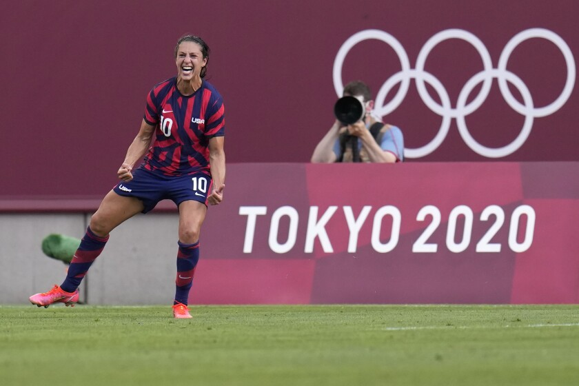 Carli Lloyd celebrates after scoring in women's soccer at the Tokyo Olympics.