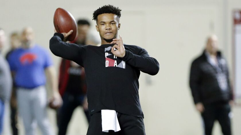 Oklahoma quarterback Kyler Murray goes through passing drills at the university's Pro Day for NFL sc