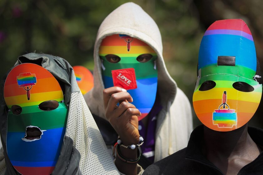 Masked Kenyan LGBT supporters at a protest against Uganda's anti-gay bill in front of the Ugandan High Commission in Nairobi, Kenya. Ugandan President Yoweri Museveni signed the bill into law Feb. 24.