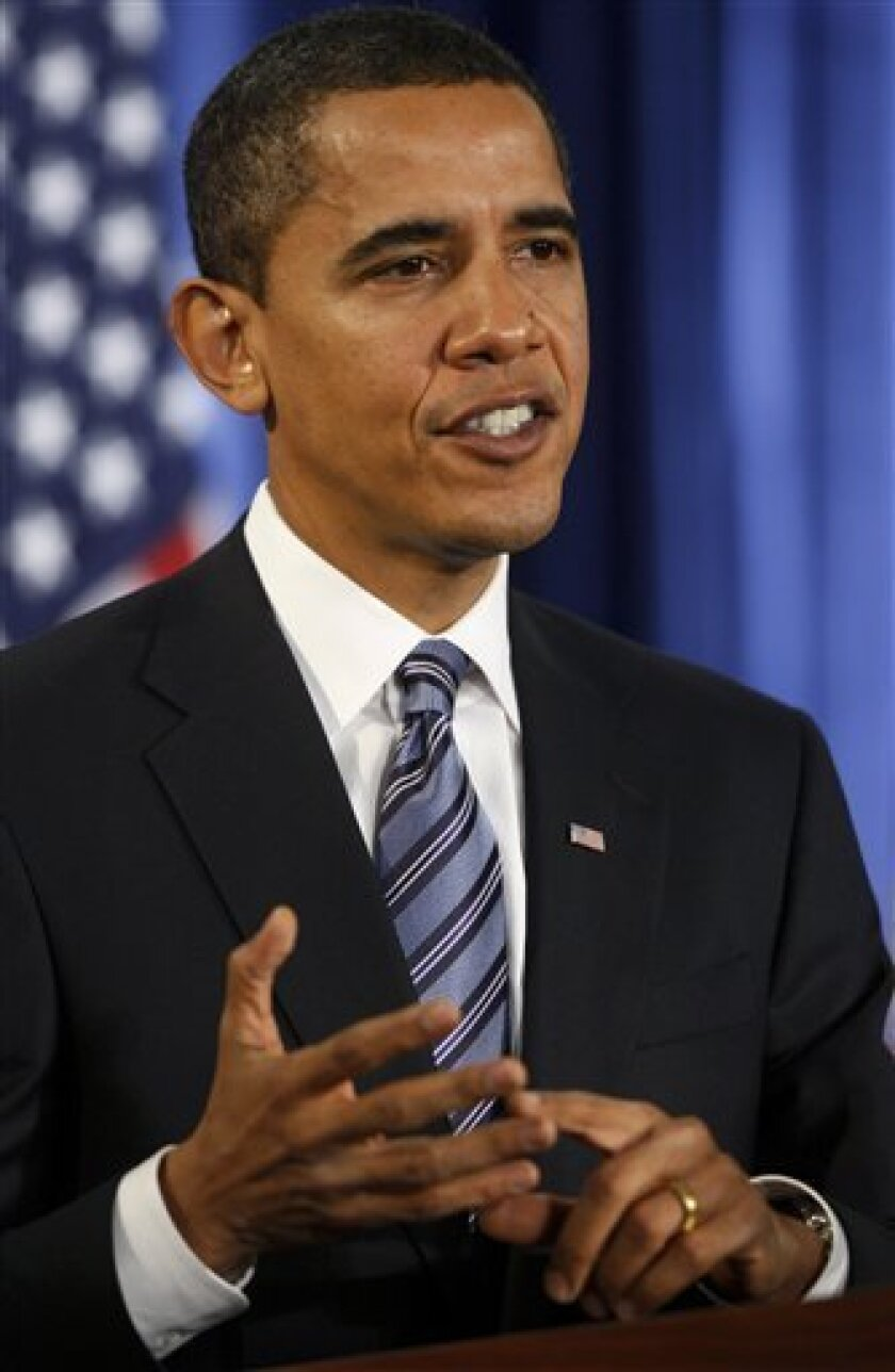 President-elect Barack Obama gestures during a news conference in Chicago, Thursday, Dec. 11, 2008. Obama, relatively young and inexperienced, is facing a rapidly growing list of monumental challenges as he prepares to take the reins of a nation in turmoil. (AP Photo/Charles Dharapak)