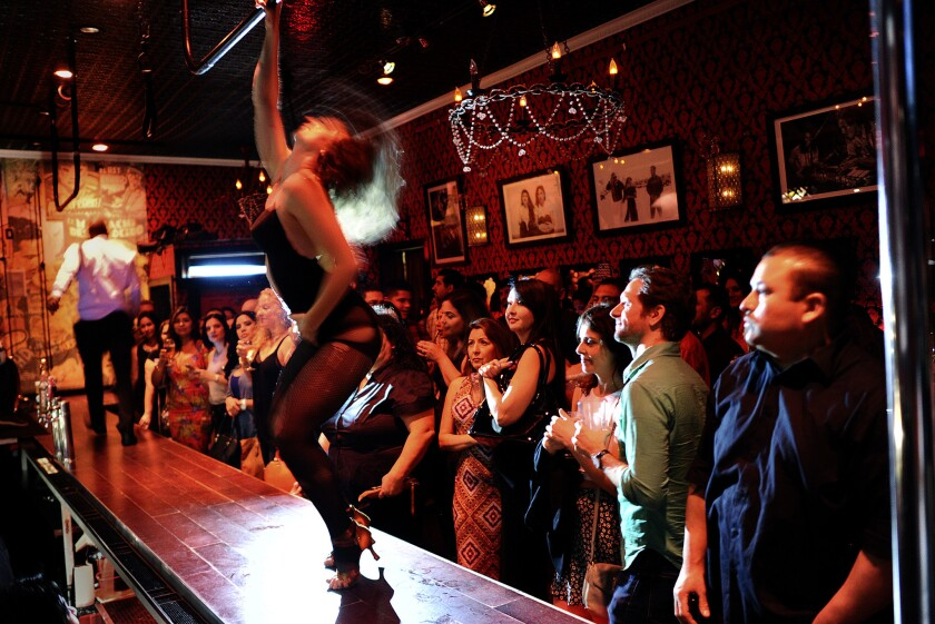 Customers enjoy a burlesque show on a Saturday night at the Eastside Luv bar in Boyle Heights.