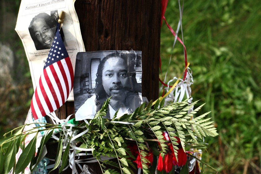 Photos of Samuel DuBose hang on a pole at a roadside memorial in Cincinnati, near where he was shot and killed by a University of Cincinnati police officer.