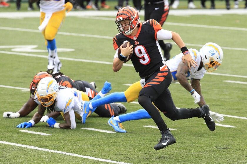 Bengals rookie quarterback Joe Burrow  runs past the Chargers for his first career touchdown.