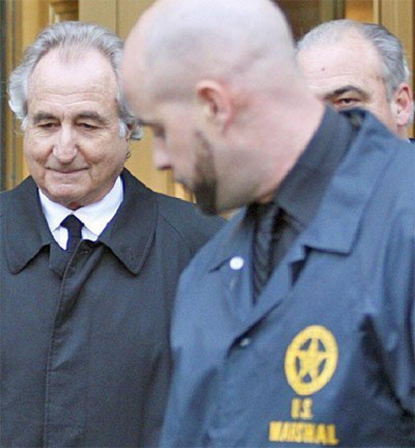 Disgraced financier Bernard Madoff left  U.S. District Court in Manhattan on Monday  after a bail hearing. (Associated Press)