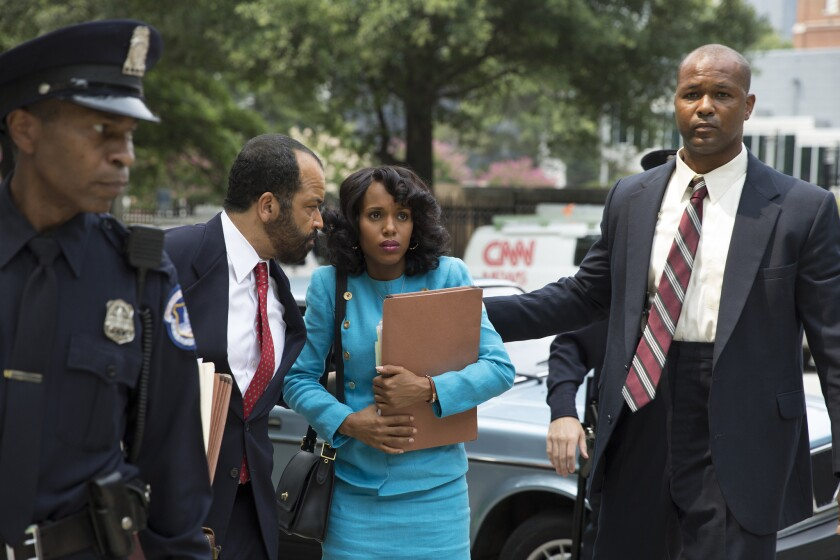 "Jeffrey Wright, left, with red tie, and Kerry Washington in ""Confirmation."""