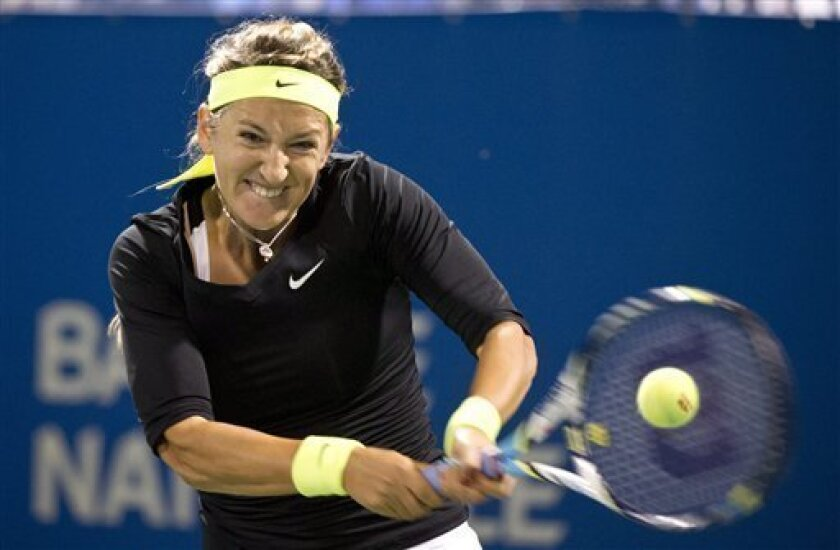 Victoria Azarenka, from Belarus, returns to Tamira Paszek, from Austria, during their match at the Rogers Cup women's tennis tournament, Thursday, Aug. 9, 2012, in Montreal. (AP Photo/The Canadian Press, Paul Chiasson)