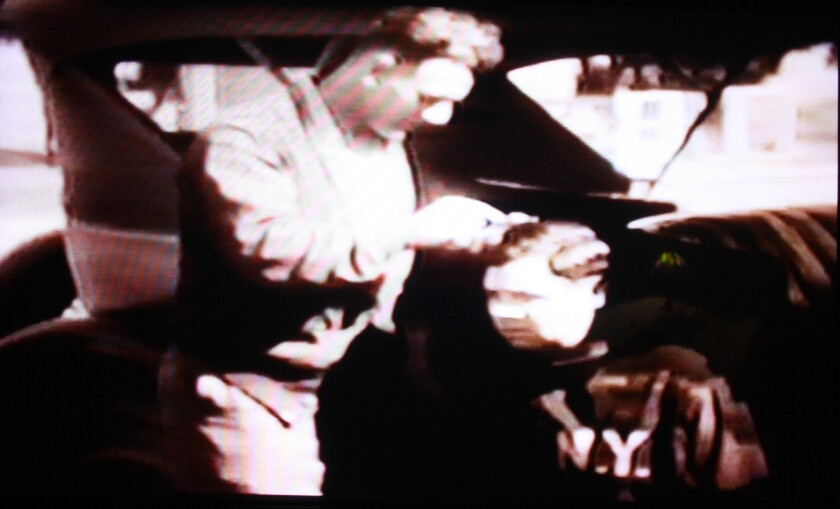 Lou Gehrig picks through Babe Ruth's hair in this screenshot from old footage.