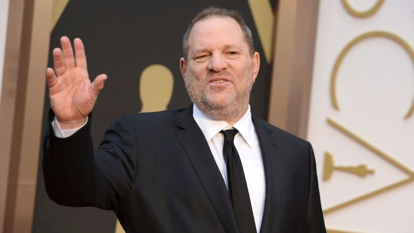 Harvey Weinstein arrives at the 2014 Oscars in Los Angeles.
