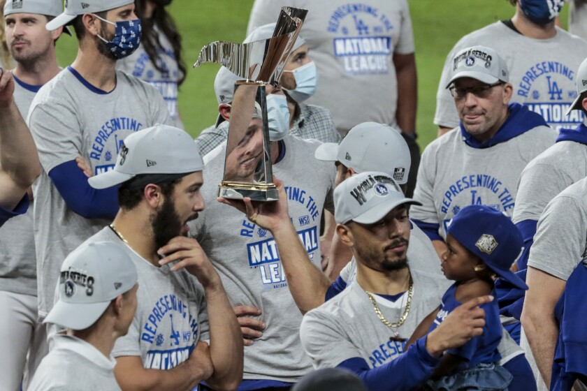 The Warren C. Giles NLCS trophy is handed around by players.