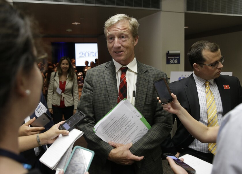Billionaire Tom Steyer talks with reporters in Sacramento in August. On Thursday, he donated $1 million to the campaign for a ballot measure to raise the tobacco tax in California.