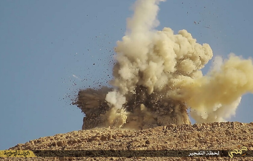Islamic State militants have destroyed two historic tombs in Palmyra, according to Syrian authorities. This undated photo released Monday by a militant website, which has been verified and is consistent with reporting by the Associated Press, shows one of two mausoleums being blown up.