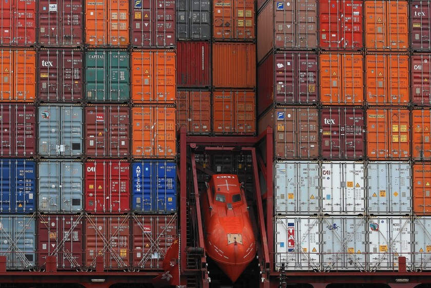 Shipping volumes at the Port of Oakland plunged 32% in January. That followed a banner year in 2014, when it saw record traffic because of L.A. and Long Beach congestion. Above, containers on a ship at the port.
