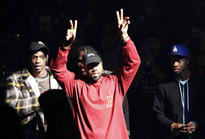 """Kanye West gestures to the audience at the unveiling of the Yeezy collection and album release for his latest album, """"The Life of Pablo,"""" Thursday, Feb. 11, 2016 at Madison Square Garden in New York. (AP Photo/Bruce Barton)"""