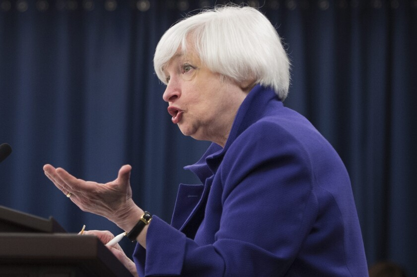 Federal Reserve Chairwoman Janet L. Yellen speaks with reporters Wednesday after the central bank announced the first increase in a key interest rate since 2006.