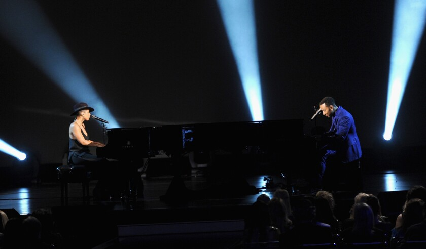 Alicia Keys and John Legend perform at the Los Angeles Convention Center on Jan. 27, 2014.