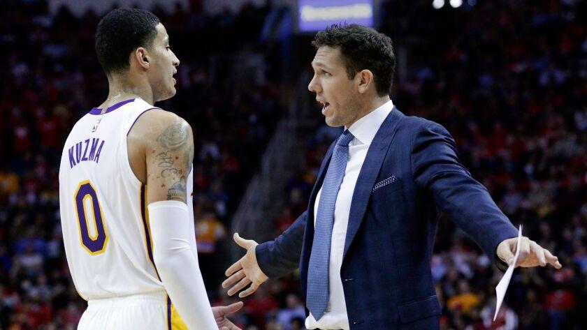 Lakers forward Kyle Kuzma talks with coach Luke Walton during a game against Houston on Dec. 20.