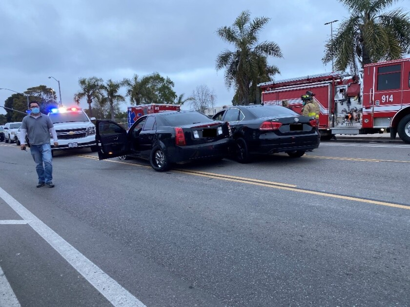 Two cars side-by-side after one sideswiped the other