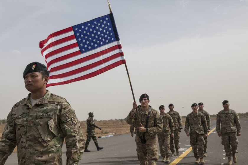 A flag bearer holds the American flag as American forces take part in the opening ceremony of Flintlock, anti-terrorism training in Thies, Senegal, Monday,  Feb. 8, 2016. Flintlock is annual military exercises  that focuses on anti-terrorism and security training by American and European security f