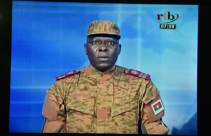 "A picture taken on Thursday shows a TV screen during the broadcast of the speech of Lt. Col. Mamadou Bamba announcing that a new ""National Democratic Council"" had put an end ""to the deviant regime of transition"" in Burkina Faso."
