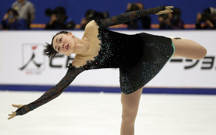 Japan's Rika Hongo competes in the Ladies Free Skating program during the ISU Grand Prix of Figure Skating at the Capital Gymnasium in Beijing, China, Saturday, Nov. 7, 2015. (AP Photo/Mark Schiefelbein)