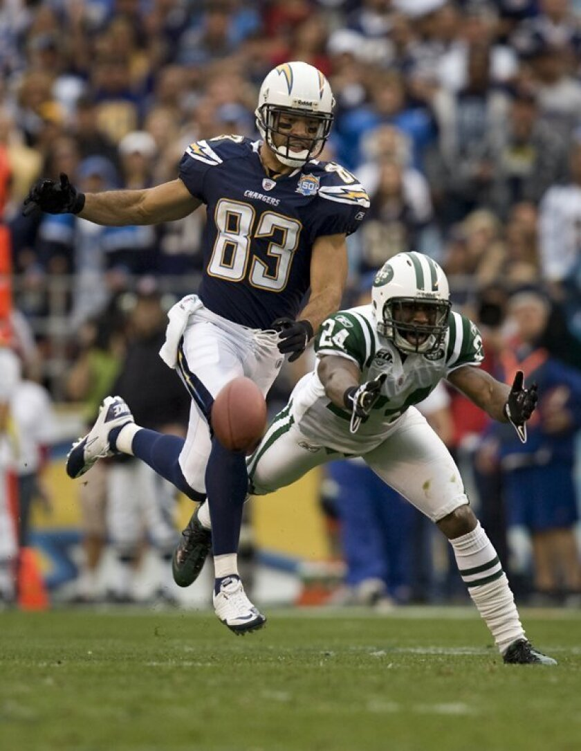 Chargers receiver Vincent Jackson and New York Jets cornerback Darrelle Revis, shown here in last January's playoff game, share the same agents and are both sitting out.