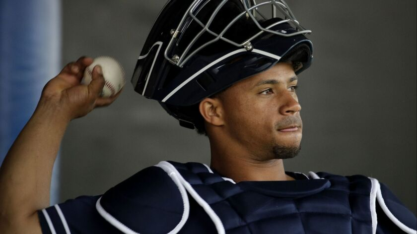 San Diego Padres catcher Francisco Mejia throws during spring training baseball practice Thursday, F