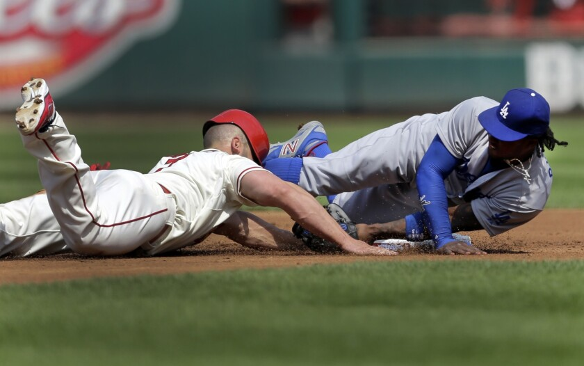St. Louis' Matt Holliday gets back to second base on a failed pick off attempt in the first inning as shortstop Hanley Ramirez tries to cover the second base.