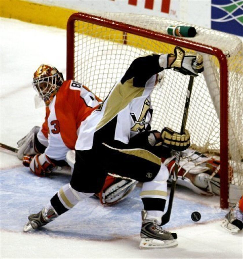 Pittsburgh Penguins' Matt Cooke prepares to shoot as Philadelphia Flyers' Martin Biron (43) defends in the second period of an NHL hockey game Tuesday, Jan. 13, 2009, in Philadelphia. Cooke scored on the shot. (AP Photo/H. Rumph Jr)