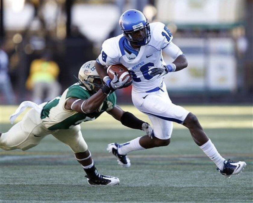 Memphis receiver Marcus Rucker (18) runs past UAB defender Jamie Bender (5) for a first down during the first half of an NCAA college football game on Saturday, Nov. 20, 2010, in Birmingham, Ala. (AP Photo/Butch Dill)