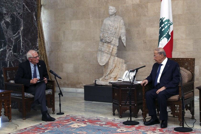 In this photo released by Lebanese government, Lebanese President Michel Aoun, right, meets with European Union foreign policy chief Josep Borrell at the Presidential Palace in Baabda, east of Beirut, Lebanon, Saturday, June. 19, 2021. Borrell berated Lebanese politicians for delays in forming a new Cabinet, warning the union could impose sanctions on those behind the political stalemate in the crisis-hit country. (Dalati Nohra/Lebanese Official Government via AP)