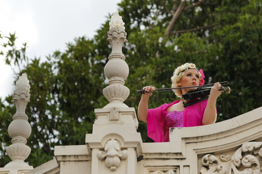 A violinist plays during the Patrons of the Prado Masterpiece Gala.