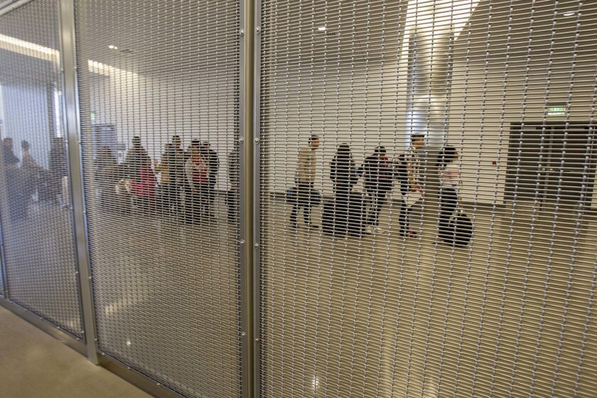 A line of asylum seekers wait in line inside the San Ysidro Port of Entry.