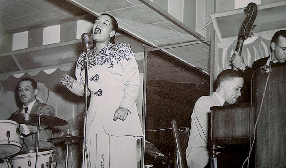 A photo hanging on a wall at the former Dunbar Hotel shows jazz great Billie Holiday performing there in the 1940s.
