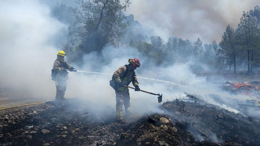Fire crews battle a wildfire near Cache Creek Road in Spring Valley, Calif., Monday, June 25, 2018.
