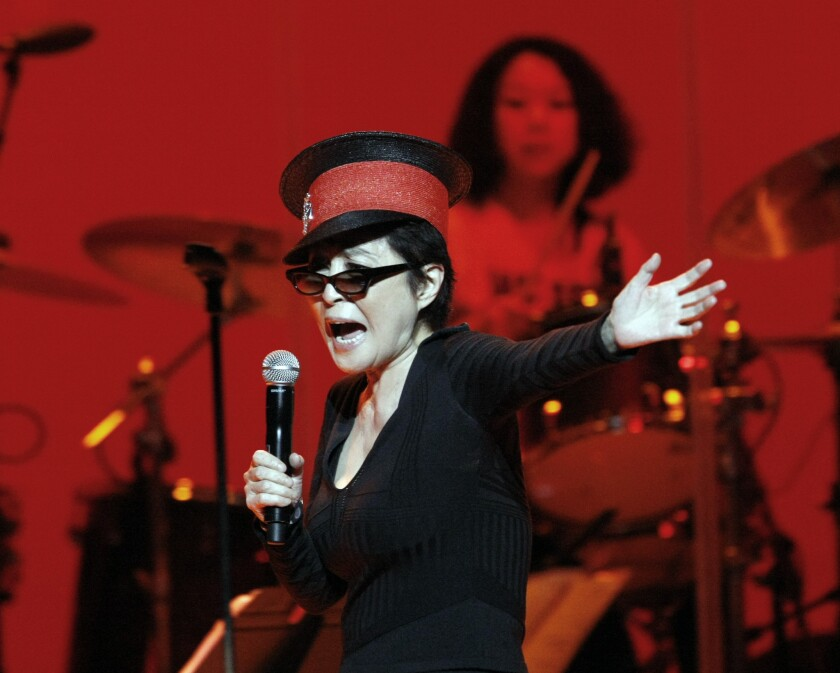 Yoko Ono performing in 2010 with the Plastic Ono Band at the Orpheum Theatre in Los Angeles.