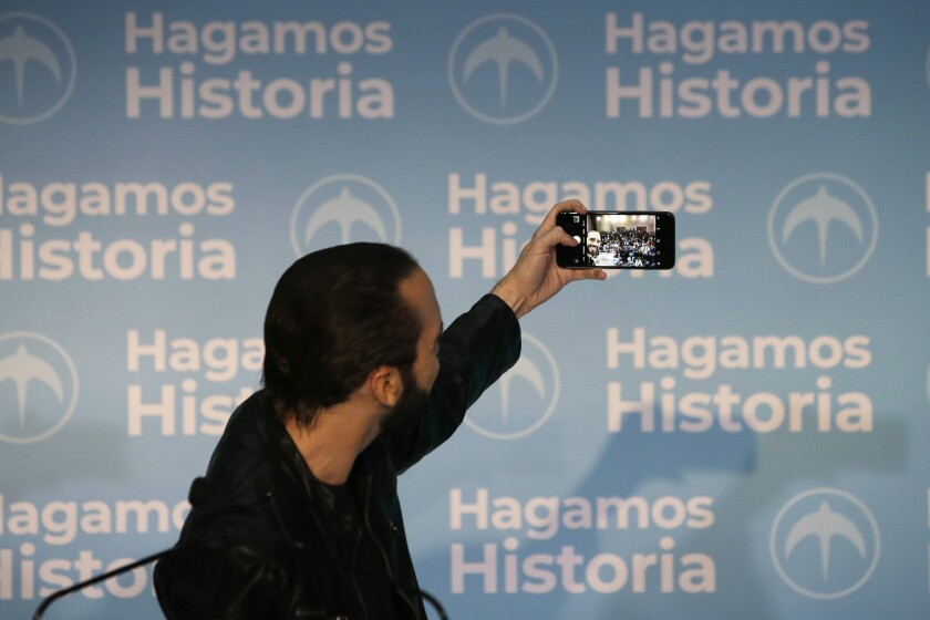 FILE - In this Feb. 3, 2019 file photo, then presidential frontrunner Nayib Bukele takes a selfie during a press conference, in San Salvador, El Salvador. Like former President Donald Trump, Bukele prefers social media over press conferences, so he can control the message. (AP Photo/Moises Castillo, File)