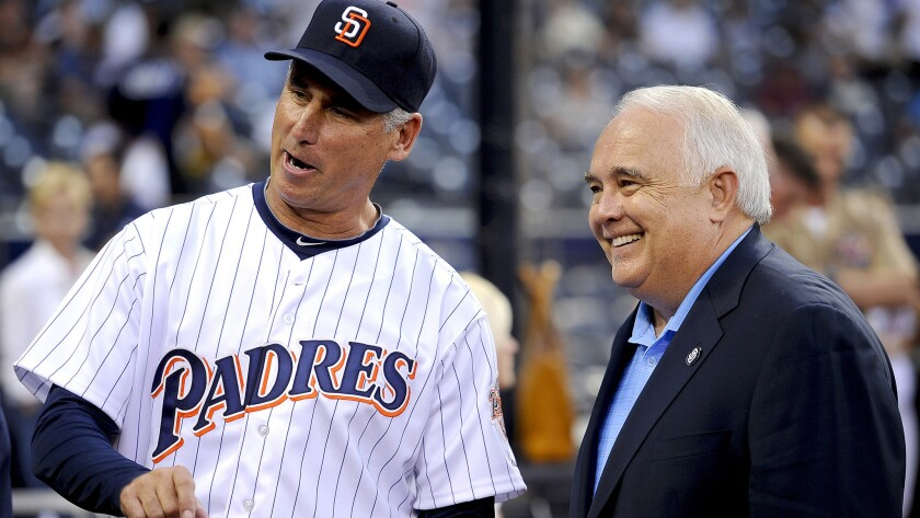 Ron Fowler, executive chairman of the San Diego Padres, chats with former manager Bud Black during a game in 2012.