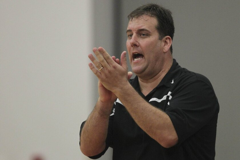 St. Augustine coach Mike Haupt's basketball team won the Division III state title this season.