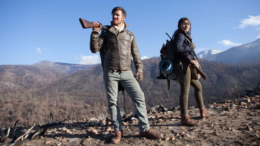 """(L-R) - Colin O'Donoghue and Lulu Antariksa in a scene from """"What Still Remains."""" Credit: Strike the"""