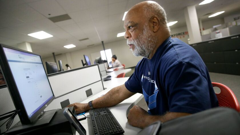 Air Force veteran Thom Brownell uses a computer to search for a job at the Texas Workforce Solutions
