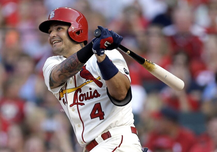 FILE - In this  Saturday, July 18, 2015 file photo, St. Louis Cardinals' Yadier Molina watches his RBI ground-rule double during the first inning of a baseball game against the New York Mets in St. Louis. St. Louis Cardinals catcher Yadier Molina has had the cast removed from his surgically repaire