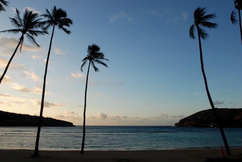 The sun rises over Oahu's Hanauma Bay near Honolulu.