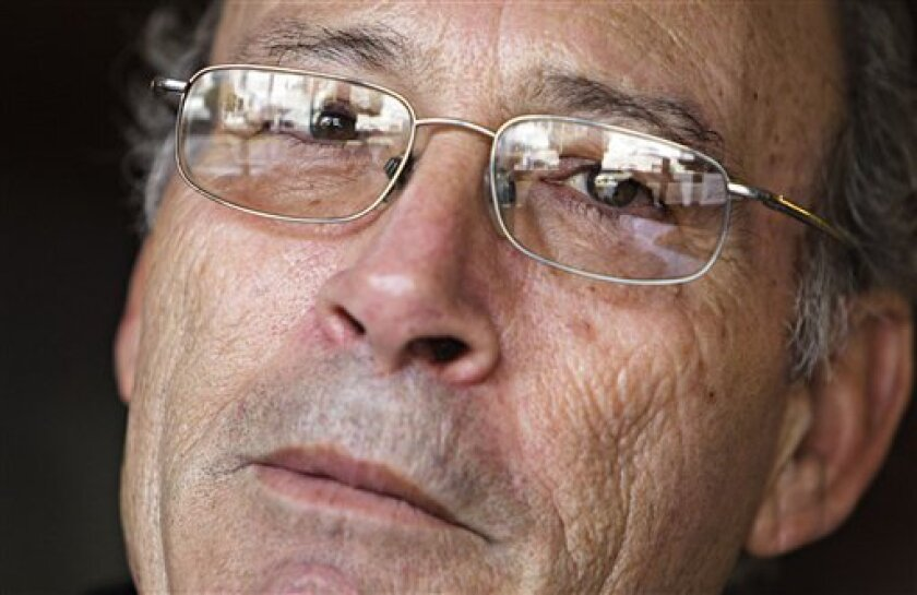 "Francisco Holgado, better known as ""Father Courage,"" reacts during an interview with The Associated Press in Jerez de la Frontera, southern Spain, on Tuesday, Nov. 30, 2010. Juan Holgado was working as a night shift gas station clerk on Nov. 22, 1995 when he was killed in Jerez. The defendants were"