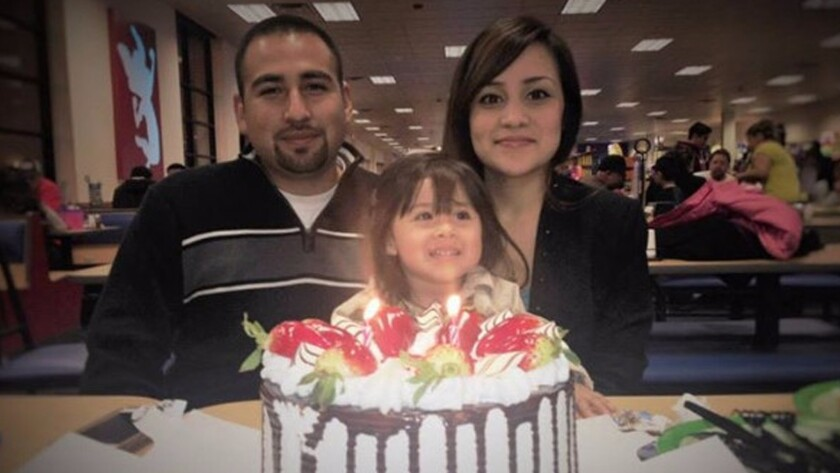 Luis Anaya and Carina Mancera attend a celebration with their 4-year-old daughter, Jennabel Anaya. Jennabel and her mother were shot to death in August.