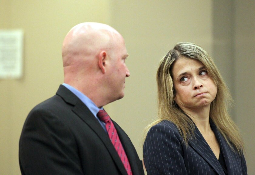 Rebecca Ocain, a San Diego County prosecutor, was sentenced on Monday for hit-and-run and DUI (her second). She appears here with defense attorney J. Gregory Turner, before Judge Matthew C. Braner in South County court.|