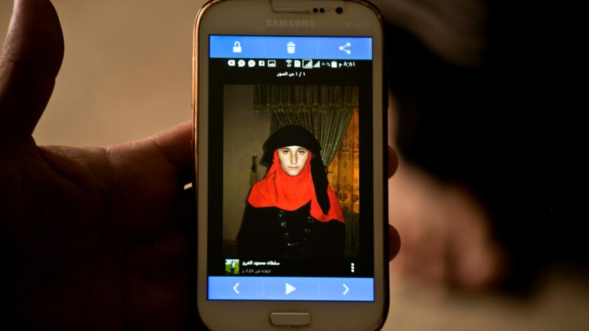 Islamic State militants took this photo of Nazdar Murat as part of a database of Yazidi girls and women they have enslaved.