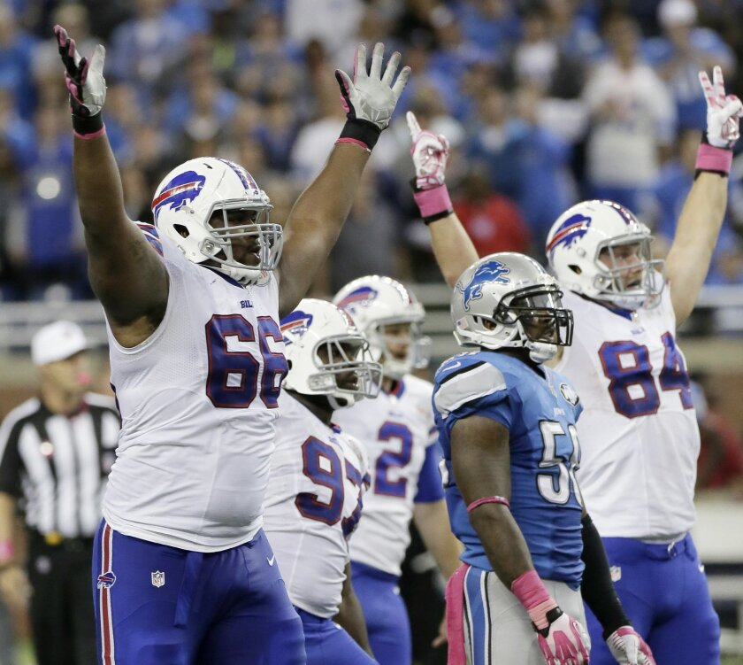 Buffalo Bills tackle Seantrel Henderson (66) celebrates as he watches a 58 -yard game-winning field goal in the fourth quarter of an NFL football game against the Detroit Lions Sunday, Oct. 5, 2014, in Detroit. The Bills defeated the Lions 17-14.(AP Photo/Duane Burleson)