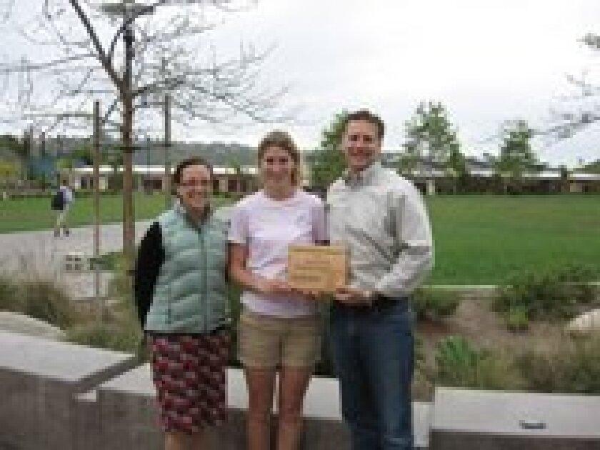 Science teacher, Melissa Sullivan, Elle Lichter and Joe Yeagley.